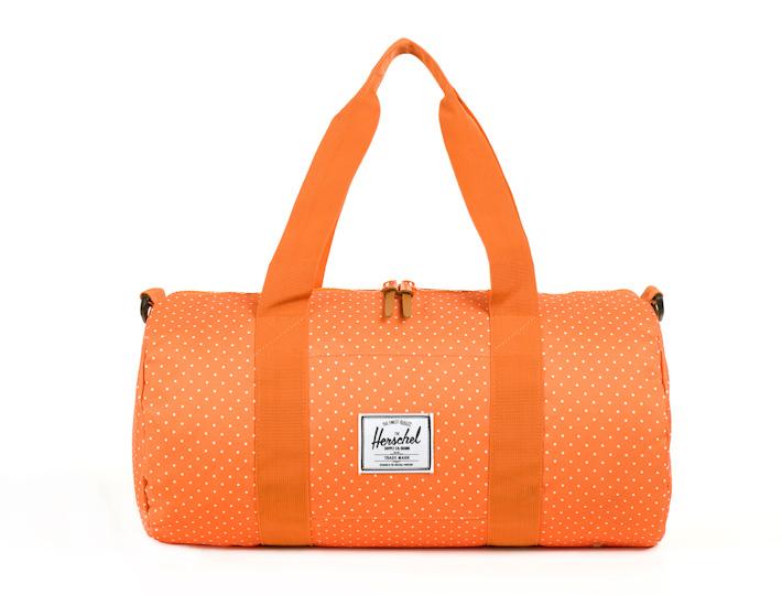 Herschell Supply příruční taška Sutton Mid, oranžová sbílými puntíky