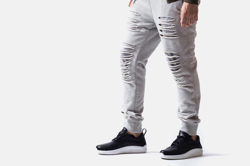 Unyforme – šedé tepláky s dírami | Pánské značkové oblečení
