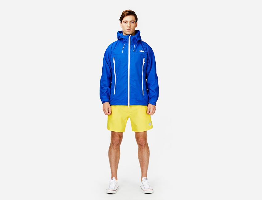 Penfield — modrá sportovní bunda s kapucí, žluté šortky/kraťasy — pánské oblečení jaro/léto 2015