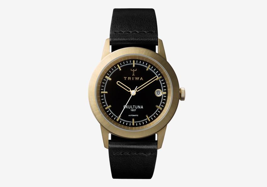 Hodinky Triwa x Skultuna — dámské a pánské luxusní hodinky z mosazi — černý kožený řemínek, ocelové pozlacené pouzdro
