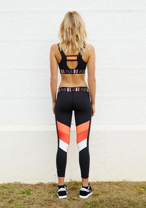 P.E Nation — černé legíny, oranžový-červený-bílý pruh — černý top, plavky — dámské sportovní oblečení