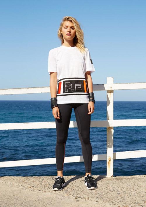 P.E Nation — bílé sportovní tričko — černé legíny — dámské sportovní oblečení