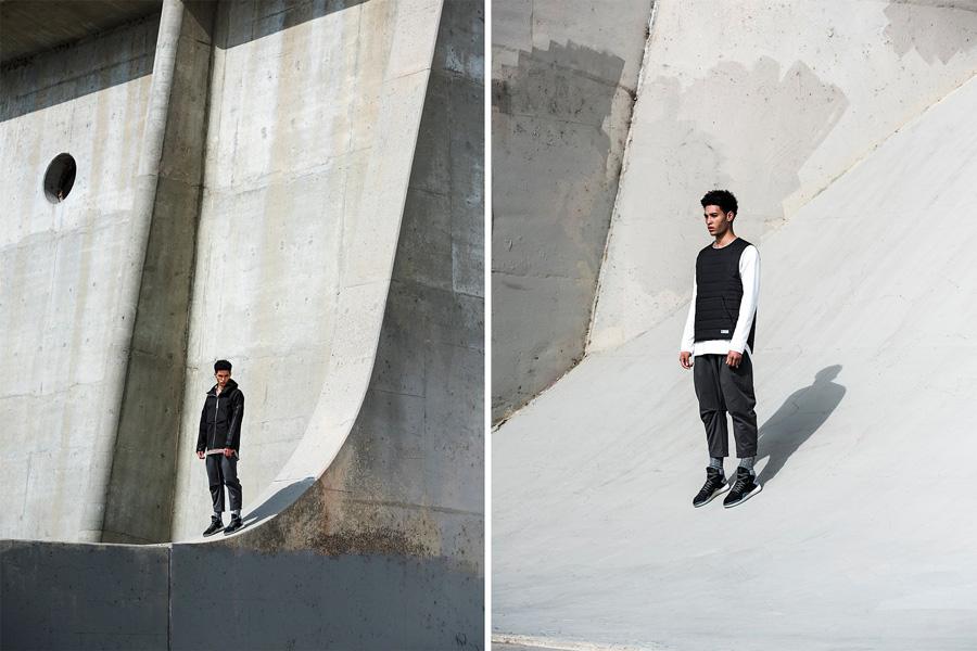 adidas Originals — Regista — černá pánská bunda — prošívaná černá vesta s klokaní kapsou — tříčtvrteční pánské kalhoty, šedé — sportovní oblečení