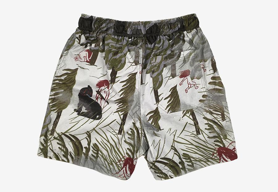 Retart — pánské koupací šortky — plavky — zelené, smetanové — swim shorts — s ilustrací, pravěké motivy — Juliana Chomová