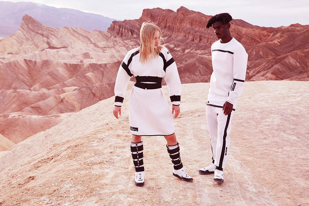 PUMA x UEG — Gravity Resistance — dámské futuristické bílé šaty, kozačky — pánská bílá mikina, kalhoty, boty — lookbook