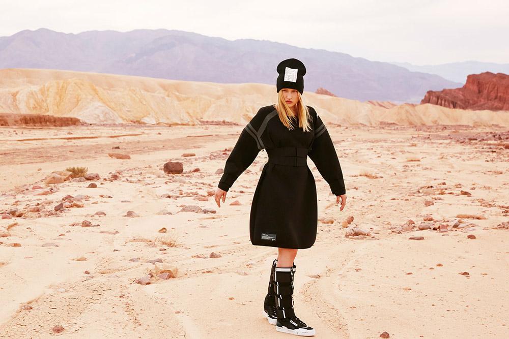 PUMA x UEG — Gravity Resistance — dámské futuristické černé šaty — futuristické vysoké tenisky, kozačky, černé — lookbook