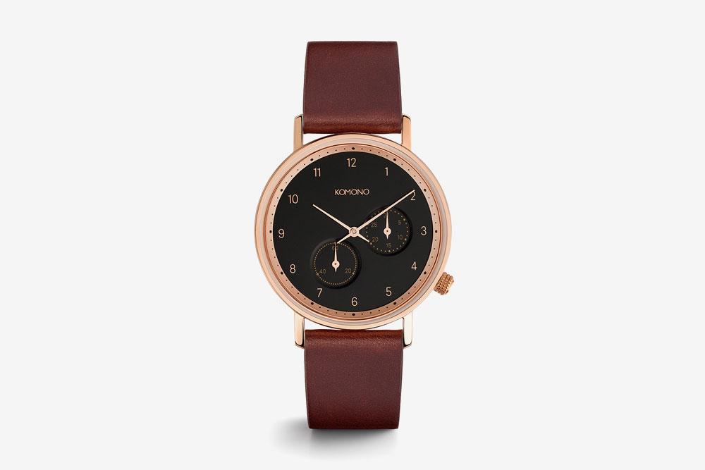Komono Walther — hodinky — náramkové — ocelové pouzdro (barva růžové zlato), černý ciferník, hnědý kožený řemínek