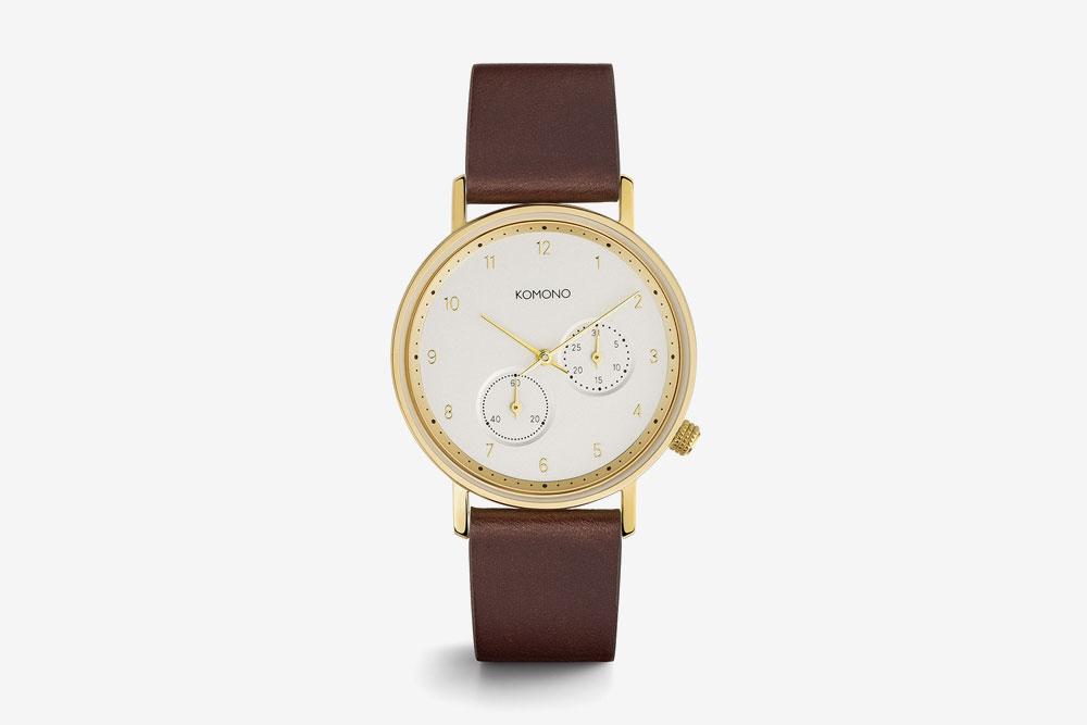 Komono Walther — hodinky — náramkové — ocelové pouzdro zlaté barvy, bílý ciferník, hnědý kožený řemínek