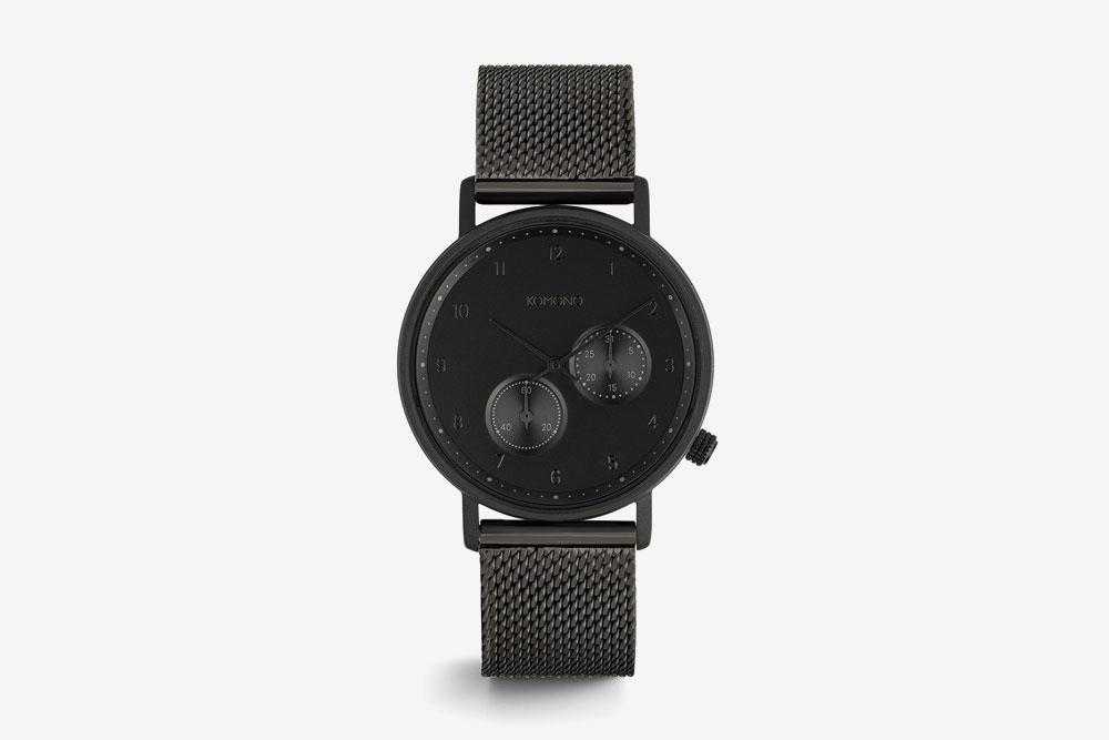 Komono Walther — hodinky — náramkové — černé ocelové pouzdro, černý ciferník, černý ocelový náramek