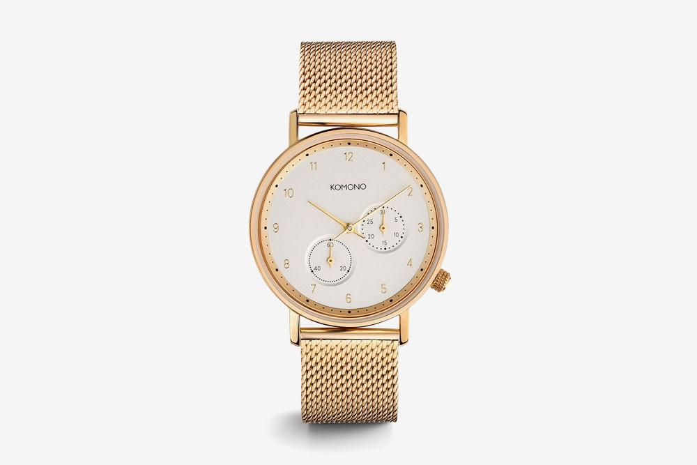 Komono Walther — hodinky — náramkové — ocelové pouzdro zlaté barvy, bílý ciferník, ocelový náramek zlaté barvy