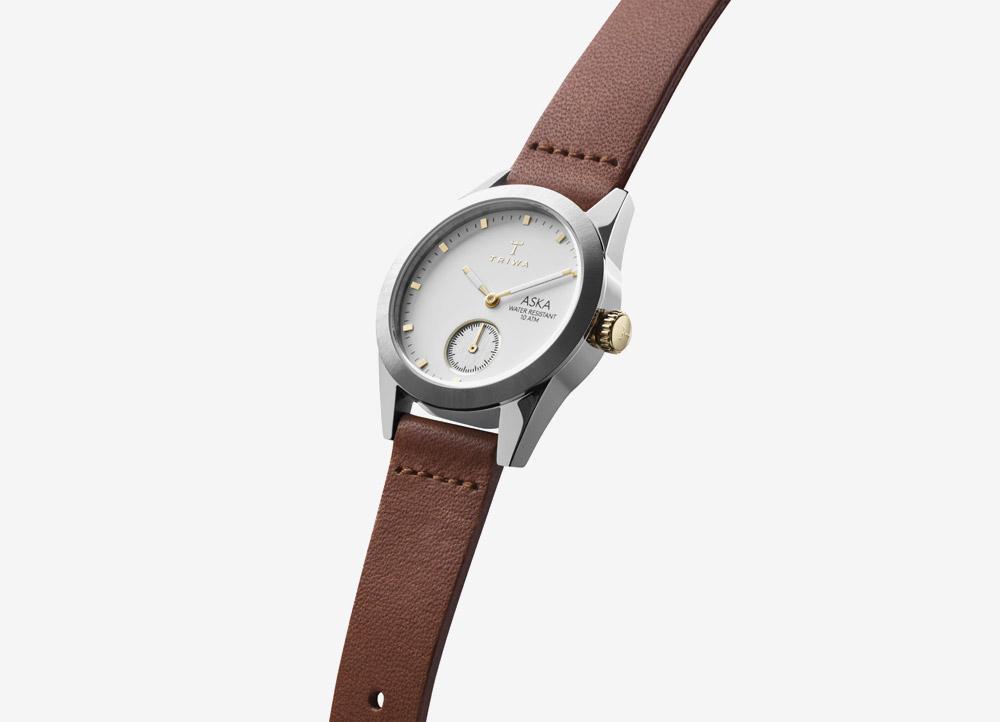 Triwa Aska — Ivory — dámské hodinky — náramkové — ručičkové — ocelové — zlaté pouzdro — bílý ciferník — černý kožený náramek