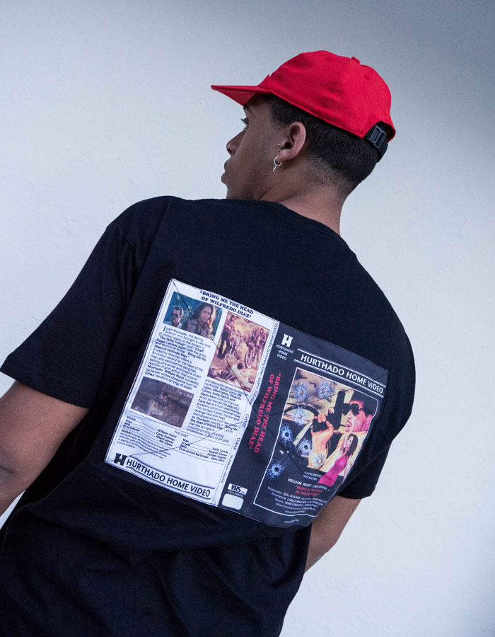 Hurthado Clo' — černé tričko s nášivkou na zádech