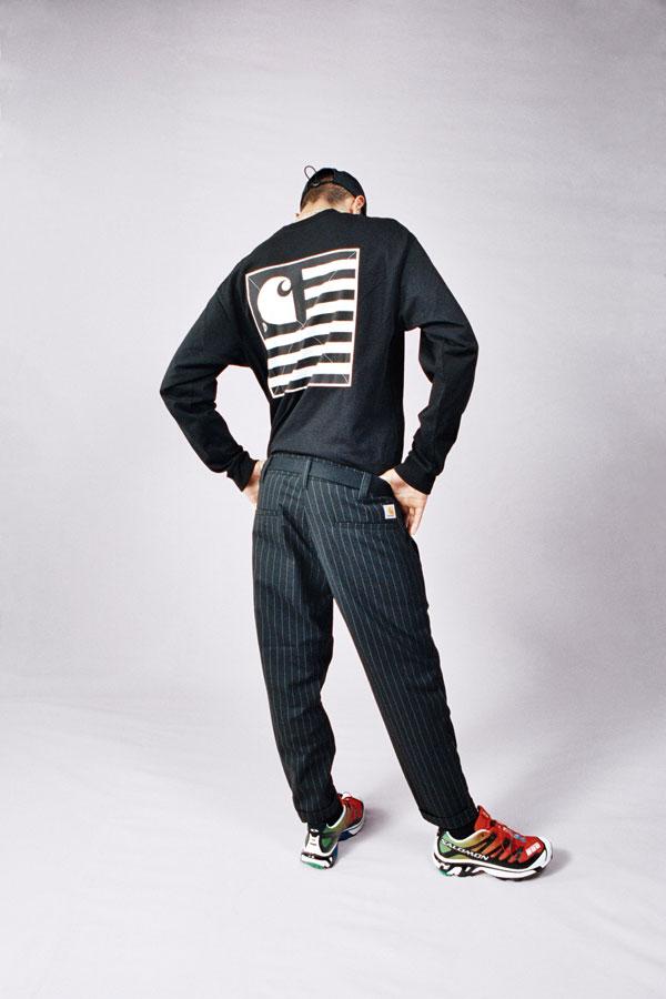 Carhartt WIP — černé kalhoty s proužky — černé tričko s dlouhými rukávy a potiskem na zádech — lookbook jaro/léto 2019