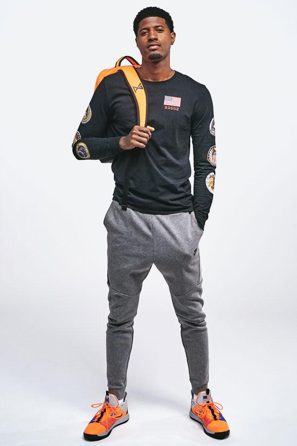 Nike PG3 — Paul George — černé tričko s nášivkami — šedé tepláky — oranžové boty PG3 — NASA